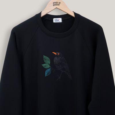 sweatshirt en coton biologique brodé avec un merle dans la nuit parisienne PhilippeGaber
