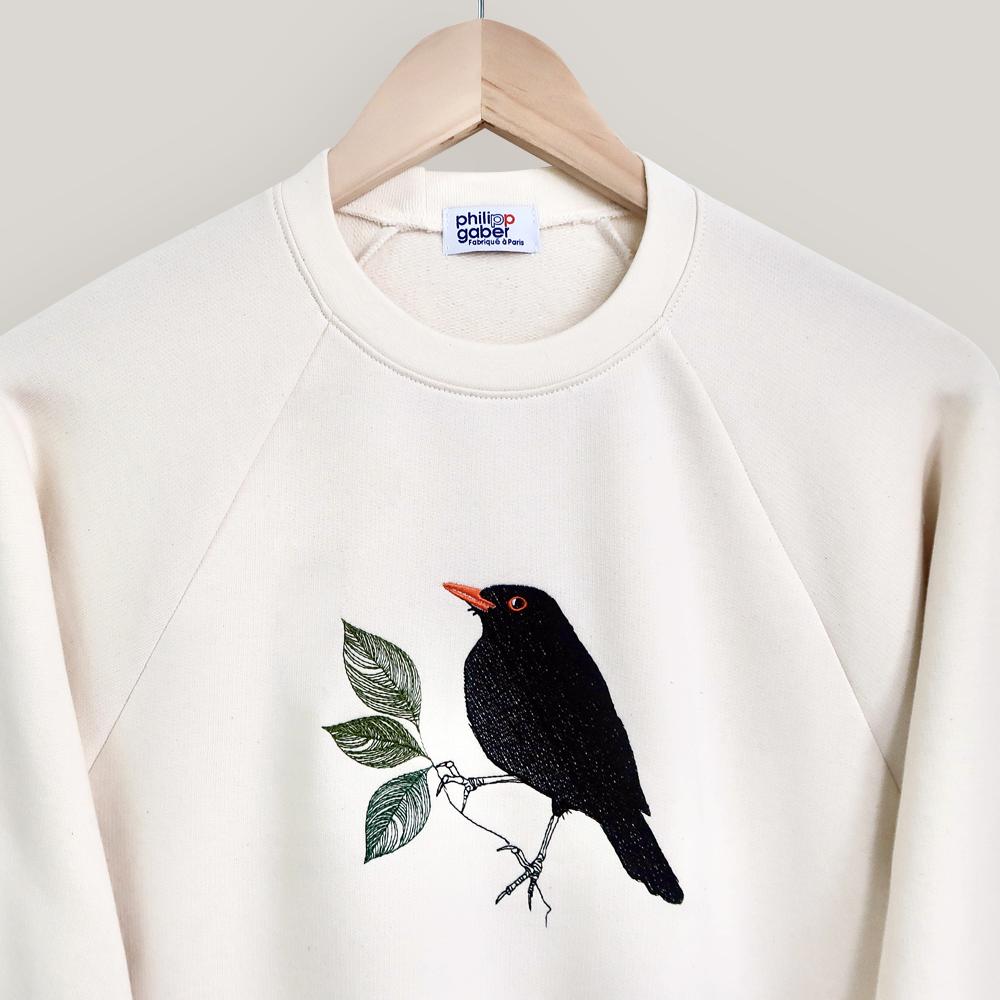 sweat-shirt coton biologique écru broderie merle parisien fabriqué et brodé à Paris Philippegaber